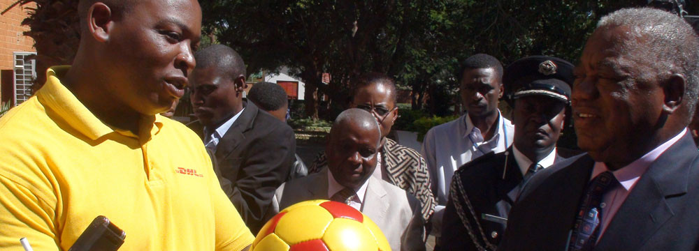 DHL present a ball to the President of Zambia