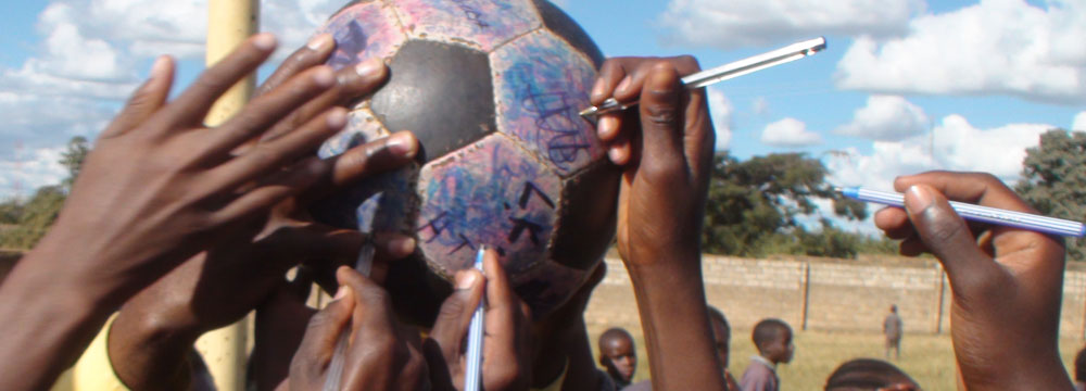 Signing The Ball at a school in Zambia